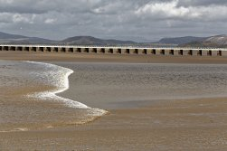 Arnside Bore with viaduct in the background